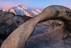 Mobius Arch and Lone Pine Peak (~Arles) Tags: rock arch stone mobiusarch mountain snow trees sand dirt outdoors alabamahills lonepinepeak sky clouds sunrise morning pink blue nature landscape natural