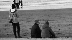 Some Sit Some Stand (byronv2) Tags: edinburgh edimbourg scotland portobello seaside coast coastal sea northsea river riverforth rnbforth firthofforth forth beach sand water peoplewatching street candid sitting seated blackandwhite blackwhite bw monochrome