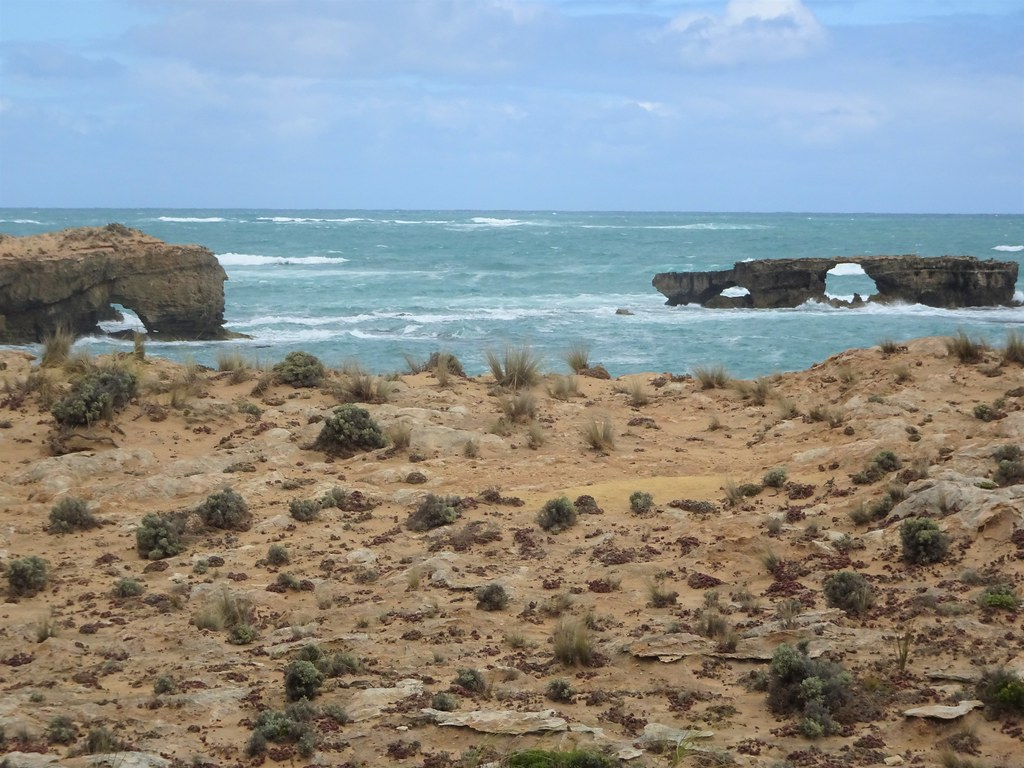 Robe in the South East of South Australia. Small rock stack and arch by Cape Dombey at the entrance to Guichen Bay and the historic town of Robe.