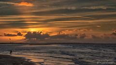 Kite Surfen at Sunset (BraCom (Bram)) Tags: 169 bracom bramvanbroekhoven brouwersdam goereeoverflakkee holland nederland netherlands noordzee northsea ouddorp southholland zuidholland avond beach cloud duinen dunes evening golf kitesurfen kitesurfer sea sky strand sunray sunset wave widescreen winter wolk zandbank zee zonsondergang