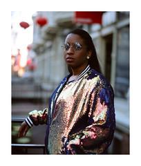 Hey (marq4porsche) Tags: model woman girl lady jacket oakland bokeh downtown city urban light gold blue black bright mamiya rz67 pro iid fujifilm provia 100f sekor 110mm film fuji color slide positive portrait analog medium format california