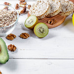 Concept diet - healthy food with muesli, avocado, kiwi and apple thumbnail