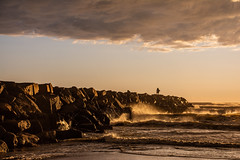 Perseverance (LifebytheShot) Tags: running water storm ocean jetty rocks clouds waves california