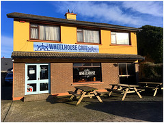 The Wheelhouse Cafe (JulieK (thanks for 8 million views)) Tags: takeaway fethardonsea ireland irish iphonese 2019onephotoeachday wheelhousecafe bench benches hbm window windows hww door building outdoor wexford bright colourful yellow