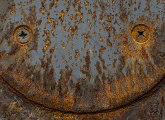 :  ) (steve2129 - on and off) Tags: d7100 afsnikkor35mm118gdx steve2129 rust stove iron corrosion yellow red brown fire decay old steel smile abandoned abstract screw texture smileyface primelens fiery