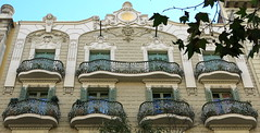One long balcony, Barcelona (Spencer Means) Tags: balcón balcony balkon architecture building house apartment railing iron ironwork wrought facade ornament dwwg window shutters modernista modernisme barcelona dreta eixample catalunya catalonia spain