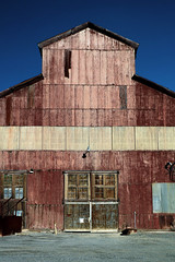 standing tall (oldogs) Tags: building architecture factory corrugated siding wooddoor salida