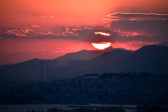 Piraeus sunset (athanecon) Tags: sunset piraeus castella kastella pireas fireinthesky sun light clouds sky sea urban urbansunset industrial industrialzone
