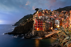 Riomaggiore (Daniele Bisognin) Tags: sunset bluehour riomaggiore cinqueterre italy sea seascape village boat water sky clouds rocks pier