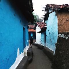 Modest Ingenuity. (Gattam Pattam) Tags: wall architecture houses village chhattisgarh india rural blue street door entrance walk mud earth