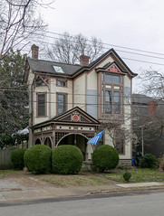 House — Lexington, Kentucky (Pythaglio) Tags: house dwelling residence 25story lexington kentucky unitedstatesofamerica us balloonframe woodsiding 11windows ornate stick latevictorian integralgutter dentils boxbay strapwork porch spandrels spindlework scrollwork bushes shrubbery hedges sidewalk street fayettecounty
