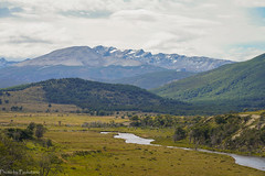 The expanse of Tierra del Fuego... / Огнеземельские дали... (Vladimir Zhdanov) Tags: travel argentina tierradelfuego landscape nature mountains mountainside snow river tree forest nothofagus field grass sky cloud water hill