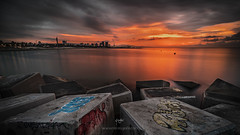 Sunrise in Barcelona (Gabriel Castro Vidal) Tags: sunset dawn riverbank sunrise water horizon over coastline seascape morning sunlight light sky beach clouds sun coast rocks outdoors summer travel costa barcelona amanecer atardecer luz grafitti playa nubes cielo spain