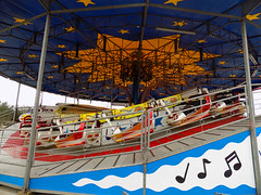 American Swing Music Ride. (dccradio) Tags: myrtlebeach sc southcarolina horrycounty broadwayatthebeach outdoor outdoors outside carnival midway fairride amusements amusementdevice mechanicalride ride rides thrillride outdooramusement fun entertainment sky cloudy overcast greyskies grayskies amusementpark park february winter monday mondaymorning morning goodmorning musicride americanswing himalaya flyingbobs musicexpress rail railing musicnotes musicalnotes catwalk nikon coolpix l340 bridgecamera bertazzon swingbuggy pavilionpark pavilionparkcentral pavilionamusementpark pavilionamusementparkcentral