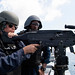 Boatswain's Mate 3rd Class Ashley Zappier fires an M240B machine gun aboard    the USS Green Bay during a weapons shoot.