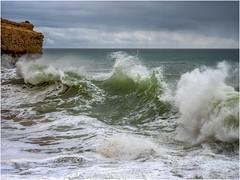 An incoming wave (Luc V. de Zeeuw) Tags: beach cloud clouds coast coastline ocean rock water wave lagoaecarvoeiro algarve portugal