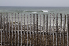 White Horses Beyond the Fence (brucetopher) Tags: winter snow beach fence fenced sea ocean wave surf waves breakers atlantic edge cliff top above overlook travel beauty storm wind wavy windy stormy gale blowing weather squall