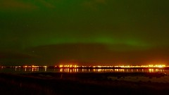 Soft Northern lights over shiny Reykjavík 2 (Jano_Calvo) Tags: northernlights iceland reykjavik night longexposure green city citynight sony a6000 ilce alpha mirrorless 1650mm water bay shore