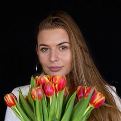 The power of flowers (piotr_szymanek) Tags: kornelia korneliaw woman young skinny face portrait studio eyesoncamera flowers longhair 1k 20f 5k 10k