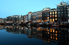 Evening in Amsterdam (Ducodaily) Tags: amsterdam nederland holland netherlands canals gracht singel reflection cityscape bluehour longexposure nikon tamron manfrotto wideangle boats lights avond evening reflectie grachtenpand
