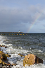 Lossiemouth harbor (rjonsen) Tags: rainbow lighthouse sea oceean water swell waves wave rock clouds cloud cloudy scotland alba harbour