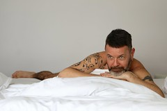 Lorentz # 4 (just.Luc) Tags: man male homme hombre uomo mann portret portrait ritratto retrato porträt face gezicht visage gesicht tattoo tatoeage tatouage ink inked baard barbe barba bart beard bed lit reclined mature handsome attractive