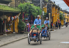 Cyclo carrying tourists on main street (phuong.sg@gmail.com) Tags: ancient architecture asia asian city cultural cycle cyclo danang haiphong hanoi heritage historical history hoian house indochina life lifestyle man old oldtown people ride rider road saigon service street sunny tour tourism tourist town transportation travel unidentified urban vehicle vietnam vietnamese