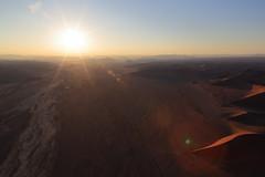 Sunrise over Sesriem corridor (Nicolas Rénac) Tags: desert namibia early morning namib désert dunes landscape paysage orange sossusvlei aerialview deadvlei vueaérienne sand africa dune plane helicopter hélicoptère aerial aerialphotography sable hill erg namibnaukluftnationalpark namibnaukluft düne