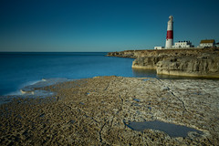 Lighthouse (paullangton) Tags: dorset lighthouse portlandbill blue longexposure jurassic calm purbeck warm rocks coastal lee flat seascape