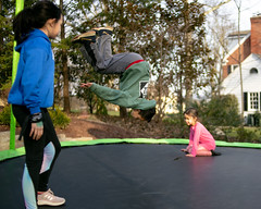 78/365 - FLIP! (Ed Gloria) Tags: son daughter brother sister trampoline outside exercise playing boy girl fun