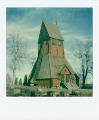 Gamla Uppsala Church Belfry (breakbeat) Tags: kmuppsala002 falured gamlauppsala scandinavian nordic church wooden sweden polaroid sx70 colourfilm square impossibleproject polaroidoriginals sx70sonar filmisnotdead 17thcentury churchyard cemetery graves graveyard gravestones cementerio friedhof cimetière cimiteri cemitério cemeteries cementerios friedhoefe cimetières cimiteris cemitérios