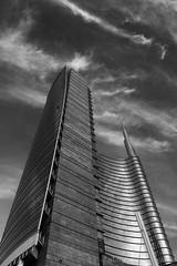 Skyscraper in Gae Aulenti square, Milan (clodio61) Tags: europe gaeaulenti italy lombardy milan architecture blackandwhite building city cityscape day exterior glass landmark modern outdoor palace park photography plant reflection skyscraper square urban