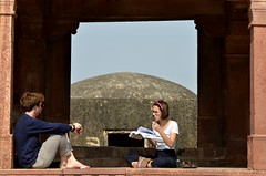 Barefoot Reading (Pedestrian Photographer) Tags: white couple tourists book read reading bare foot feet fatehpur sikri india man woman glasses sitting sit seated reader