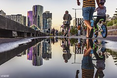 Walk On By (red stilletto) Tags: melbourne docklands famousflickrfive summer sunset reflection reflections puddle walk
