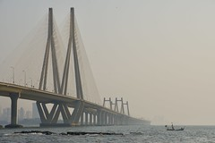 Headed Out (brantliveson) Tags: bridge boat sunset orange blue ocean sea sky waves suspension golden mumbai india bombay beauty sony