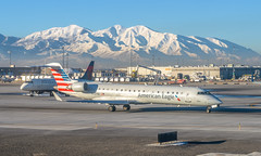 American CRJ-700 (SLC) (ruifo) Tags: nikon d850 nikkor 50mm f12 ais salt lake city international airport utah ut us usa airplane aircraft aeronave avion avión aviao avião aviacion aviación aviacao aviação aviation spotting spotter american airlines air line lines eagle bombardier crj701er n727sk crj 700 crj700 taxing rock mountains mountain montaña montanha