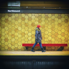Walking in Circles (A Great Capture) Tags: metro agreatcapture agc wwwagreatcapturecom adjm ash2276 ashleylduffus ald mobilejay jamesmitchell toronto on ontario canada canadian photographer northamerica torontoexplore winter l'hiver 2019 subway ttc transit commute spadina station walking circles woman northbound tile square 1x1 red bench