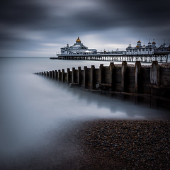 The Pier (Explored) (Lloyd Austin) Tags: explore the pier eastbourne eastbournepier eastsussex england gb sky sea land groyne pebbles stones beach shoreline coastal colour cool dark ethereal still slow longexposure tide seascape landscape unitedkingdom uk light exposure march shadows coast outside day formatthitech filters sigma1750mm 3lt cablerelease d7200 nikon lightroom photoshop