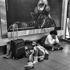 The Part of the Romantic Travel Adventure That Doesn't Make It To Instagram (Steve Mitchell Gallery) Tags: people couples adventures romance travel traveling airport airports wait waiting tired bored street