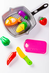 Plastic children's toys vegetables, frying pan, knife and tray (wuestenigel) Tags: vegetable tray color kid fish table knife eggplant play corn kitchen vegetables background plastic fryingpan food green fruit object strawberry toy yellow baby white noperson keineperson kunststoff desktop farbe isolated isoliert equipment ausrüstung tool werkzeug closeup nahansicht lebensmittel set einstellen health gesundheit medicine medizin healthy gesund image bild illustration glazed glasiert medical medizinisch instrument bright hell cooking kochen
