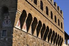 Battlement corbels, Palazzo Vecchio, Piazza della Signoria, Florence. (edk7) Tags: nikond300 nikonnikkor18200mm13556gedifafsvrdx edk7 2008 italia italy tuscany florence toscana firenze piazzadellasignoria palazzovecchio arnolfodicambio12991315 romanesque crenellated fortresspalace townhall medieval stone cityscape city urban architecture building oldstructure familycoatsofarms coatofarms escutcheon restored unescoworldheritagesite stonework arcade arch window sky colour battlement corbel