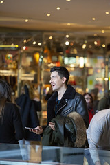 094A4075 v2 (Wheels Down) Tags: guy male handsome smile shopping candid nyc leather jacket interior crowd