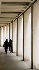 Repetitive (CoolMcFlash) Tags: street streetphotography candid vienna people walking corridor gangway repetition strase wien personen gehen korridor durchgang fotografie photography fuji fujifilm xt2 xf18135mmf3556r lm ois wr city citylife row reihe hintereinander geometry geometrie