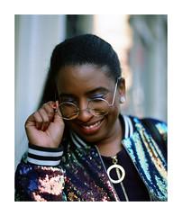 That Smile (marq4porsche) Tags: portrait model woman color fashion smile face person street outdoors city urban jacket glasses oakland california bokeh light shade film analog fuji fujifilm provia 100f medium format mamiya rz67 pro iid 110mm girl lovely