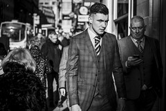 Suited (Leanne Boulton) Tags: people urban street candid portrait portraiture streetphotography candidstreetphotography candidportrait streetportrait eyecontact candideyecontact streetlife groupshot young man male face eyes expression mood feeling emotion suit tie waistcoat smart style fashion dapper sunlight busy sidewalk tone texture detail depthoffield bokeh naturallight outdoor light shade shadow city scene human life living humanity society culture lifestyle canon canon5dmkiii 70mm ef2470mmf28liiusm black white blackwhite bw mono blackandwhite monochrome glasgow scotland uk leanneboulton