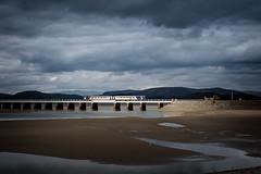 A shaft on the bridge (Mister Oy) Tags: arnside bridge viaduct dmu train unit kent estuary sand sea clouds moody sunlight fujix100f