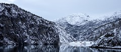 Mostraumen in a wintry Osterfjord (Wouter de Bruijn) Tags: fujifilm xt2 fujinonxf35mmf14r winter snow water reflections mountains mountain nature landscape outdoor house houses building buildings mirror tree trees pine mostraumen mo osterfjord bergen hordaland norway norge