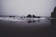 Hot sand on toes, cold sand in sleeping bags (gabyuchi1) Tags: nature beach gloomy dark grey water black sand reflection deep