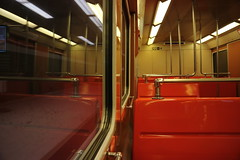 Empty orange train carriage, Helsinki Metro (Joshua Khaw) Tags: train metro orange seat helsinki inside interior railway finland underground bench reflection window empty carriage