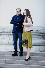 Theatre Night (Ktoine) Tags: couple street moscow theatre tall bolshoi skirt candid legs heels wait waiting crossed arms hair glasses stairs bag goingout